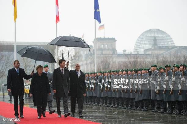 German Chancellor Angela Merkel welcomes Canadian Prime Minister Justin Trudeau with military honors in front of the Chancellery on February 17 2017...