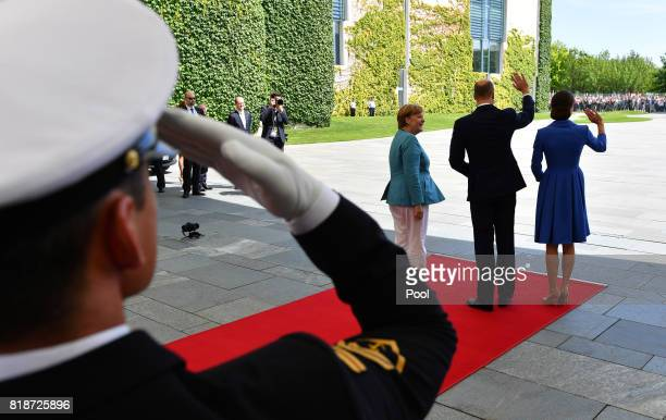 German Chancellor Angela Merkel welcomes Catherine Duchess of Cambridge and Prince William Duke of Cambridge at the Chancellery during an official...