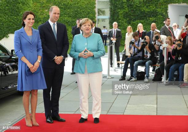German Chancellor Angela Merkel welcomes Catherine Duchess of Cambridge and Prince William Duke of Cambridge at the Chancellery on the first day of...