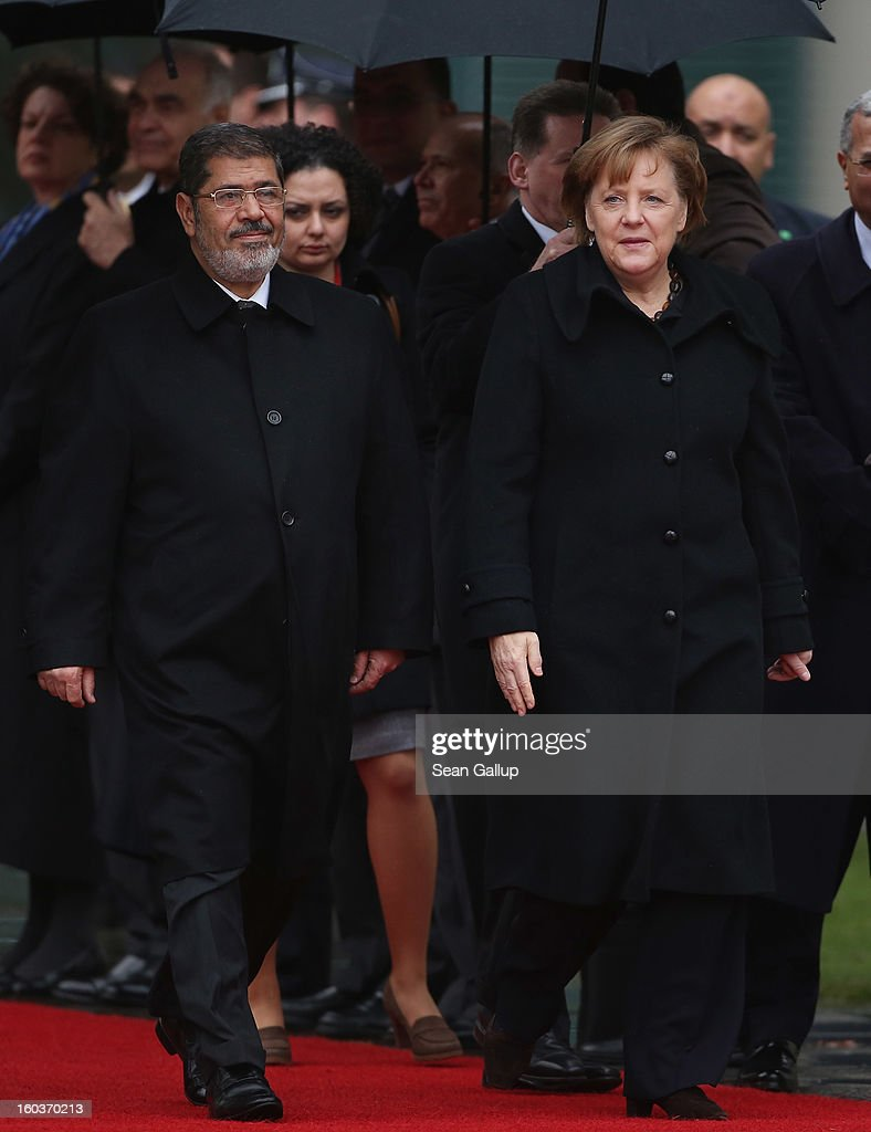 German Chancellor <a gi-track='captionPersonalityLinkClicked' href=/galleries/search?phrase=Angela+Merkel&family=editorial&specificpeople=202161 ng-click='$event.stopPropagation()'>Angela Merkel</a> welcomes Egyptian President Mohamed Mursi upon his arrival at the Chancellery on January 30, 2013 in Berlin, Germany. Mursi has come to Berlin despite the ongoing violent protests in recent days in cities across Egypt that have left at least 50 people dead. Mursi is in Berlin to seek both political and financial support from Germany.