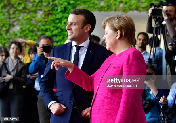 German Chancellor Angela Merkel welcomes French President Emmanuel Macron for talks on strengthening the EU a day after the new French president took...