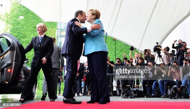 German Chancellor Angela Merkel welcomes French President Emmanuel Macron on June 29 2017 at the Chancellery in Berlin ahead of a meeting with...