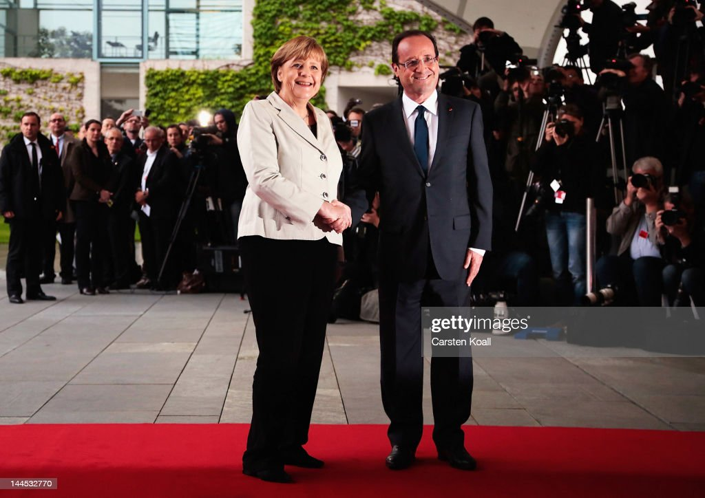 German Chancellor <a gi-track='captionPersonalityLinkClicked' href=/galleries/search?phrase=Angela+Merkel&family=editorial&specificpeople=202161 ng-click='$event.stopPropagation()'>Angela Merkel</a> welcomes French President Francois Hollande at the Chancellery hours after Hollande's inauguration in Paris on May 15, 2012 in Berlin, Germany. Hollande has come to Berlin to discuss the current European debt crisis with Merkel and most importantly to find common ground, as he hopes to resolve the crisis with measures that mark a departure from the austerity packages favoured by Merkel.