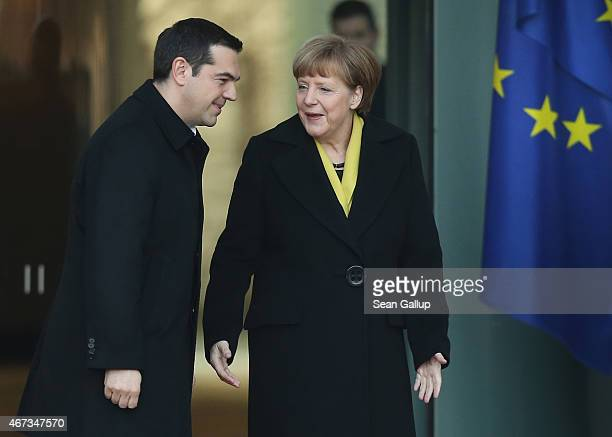 German Chancellor Angela Merkel welcomes Greek Prime Minister Alexis Tsipras upon his arrival for talks at the Chancellery on March 23 2015 in Berlin...