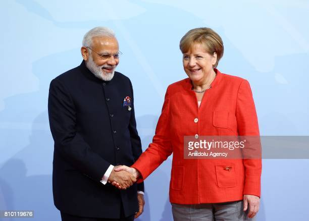 German Chancellor Angela Merkel welcomes Indian Prime Minister Narendra Modi during G20 Leaders' Summit in Hamburg Germany on July 07 2017 Germany is...
