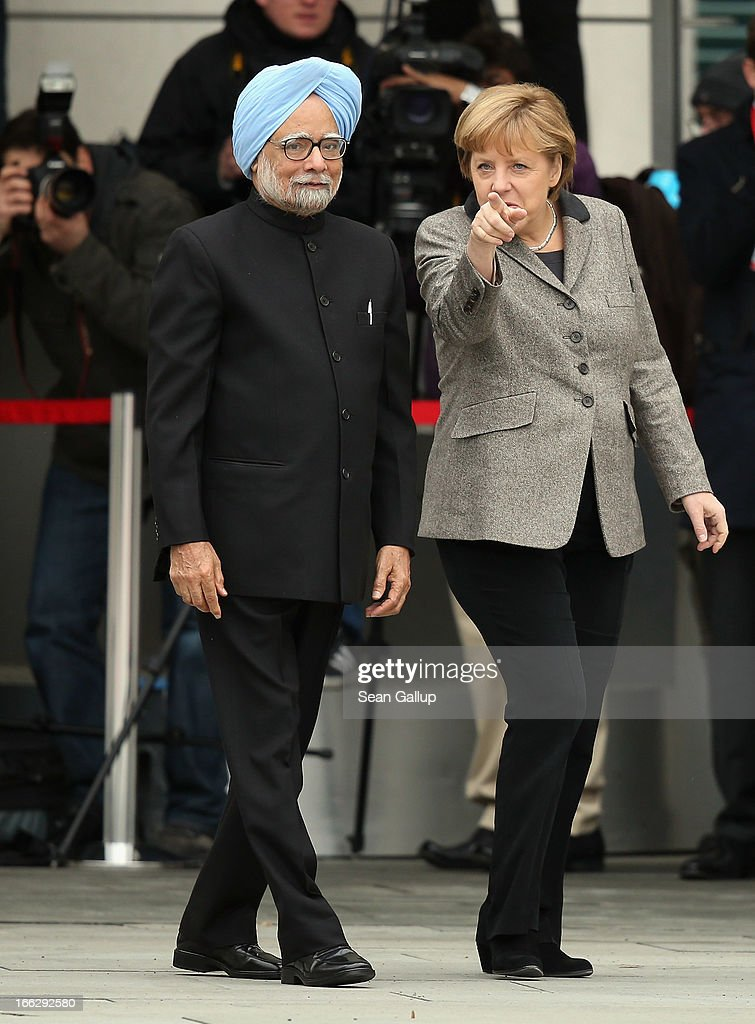 German Chancellor Angela Merkel (R) welcomes Indian Prime Minister <a gi-track='captionPersonalityLinkClicked' href=/galleries/search?phrase=Manmohan+Singh&family=editorial&specificpeople=227120 ng-click='$event.stopPropagation()'>Manmohan Singh</a> at the Chancellery on April 11, 2013 in Berlin, Germany. Singh and the Indian government are in Berlin to participate in German-Indian government consultations.
