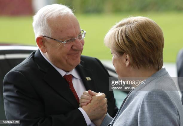 German Chancellor Angela Merkel welcomes Israeli President Reuven Rivlin in the courtyard of the german chancellory on September 7 2017 in Berlin...