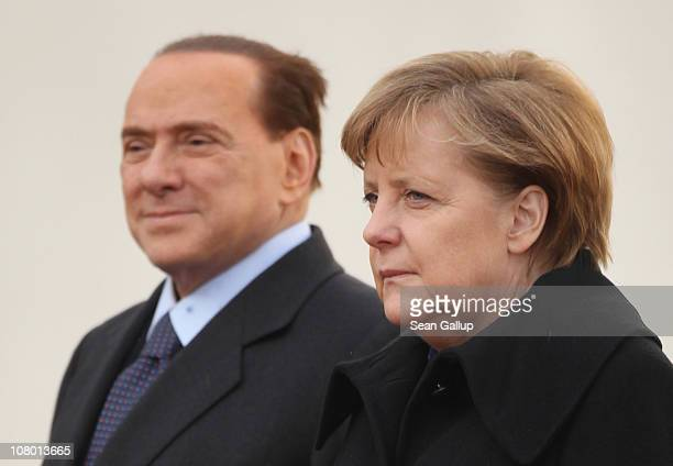German Chancellor Angela Merkel welcomes Italian Prime Minister Silvio Berlusconi at the Chancellery on January 12 2011 in Berlin Germany Berlusconi...