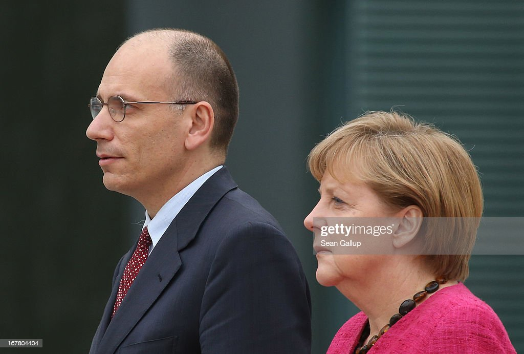 German Chancellor <a gi-track='captionPersonalityLinkClicked' href=/galleries/search?phrase=Angela+Merkel&family=editorial&specificpeople=202161 ng-click='$event.stopPropagation()'>Angela Merkel</a> welcomes new Italian Prime Minister <a gi-track='captionPersonalityLinkClicked' href=/galleries/search?phrase=Enrico+Letta&family=editorial&specificpeople=2915592 ng-click='$event.stopPropagation()'>Enrico Letta</a> at the Chancellery on April 30, 2013 in Berlin, Germany. Letta is in Germany on his first official foreign visit abroad since taking office. The two leaders discussed the current financial situation in Europe.