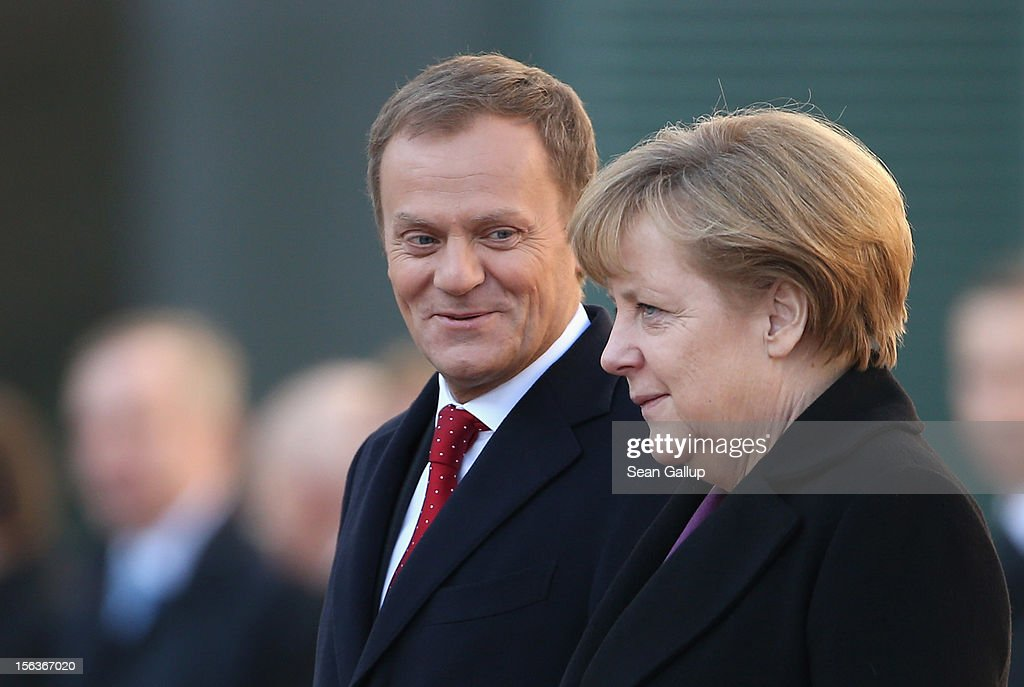 German Chancellor <a gi-track='captionPersonalityLinkClicked' href=/galleries/search?phrase=Angela+Merkel&family=editorial&specificpeople=202161 ng-click='$event.stopPropagation()'>Angela Merkel</a> welcomes Polish Prime Minister <a gi-track='captionPersonalityLinkClicked' href=/galleries/search?phrase=Donald+Tusk&family=editorial&specificpeople=870281 ng-click='$event.stopPropagation()'>Donald Tusk</a> at the Chancellery on November 14, 2012 in Berlin, Germany. Tusk and his delegation are in Berlin for German-Polish government consultations.