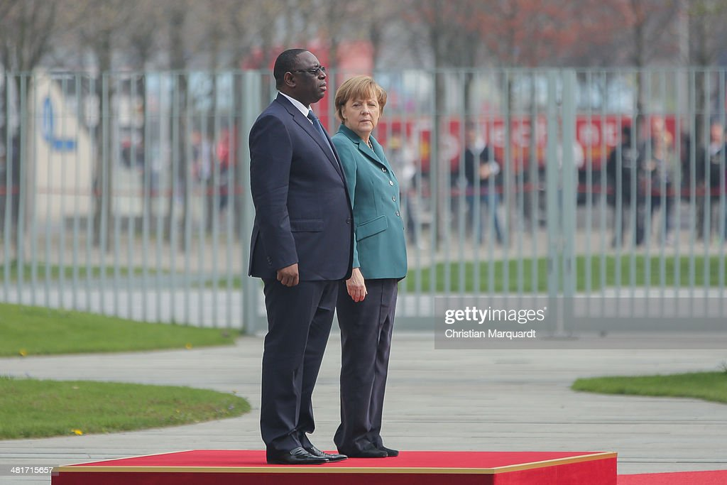 German Chancellor <a gi-track='captionPersonalityLinkClicked' href=/galleries/search?phrase=Angela+Merkel&family=editorial&specificpeople=202161 ng-click='$event.stopPropagation()'>Angela Merkel</a> welcomes President of Senegal <a gi-track='captionPersonalityLinkClicked' href=/galleries/search?phrase=Macky+Sall&family=editorial&specificpeople=598630 ng-click='$event.stopPropagation()'>Macky Sall</a> with military honors in the Chancellery on March 31, 2014 in Berlin, Germany. President <a gi-track='captionPersonalityLinkClicked' href=/galleries/search?phrase=Macky+Sall&family=editorial&specificpeople=598630 ng-click='$event.stopPropagation()'>Macky Sall</a> is on a two-day visit to Germany, the first official visit made by a Senegalese president since 2006.