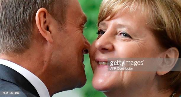 German Chancellor Angela Merkel welcomes President of the European Council Donald Tusk on June 29 2017 at the Chancellery in Berlin ahead of a...