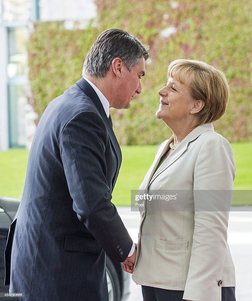 German Chancellor <a gi-track='captionPersonalityLinkClicked' href=/galleries/search?phrase=Angela+Merkel&family=editorial&specificpeople=202161 ng-click='$event.stopPropagation()'>Angela Merkel</a> welcomes Prime Minister of Croatia <a gi-track='captionPersonalityLinkClicked' href=/galleries/search?phrase=Zoran+Milanovic&family=editorial&specificpeople=4663917 ng-click='$event.stopPropagation()'>Zoran Milanovic</a> to the German government Balkan conference at the Chancellery on August 28, 2014 in Berlin, Germany. The leaders of Albania, Kosovo, Croatia, Bosnia-Herzegovina, Slovenia, Serbia, Montenegro and Macedonia are participating in the conference that also includes Austrian Chancellor Werner Faymann and European Commission President Jose Manuel Barroso.