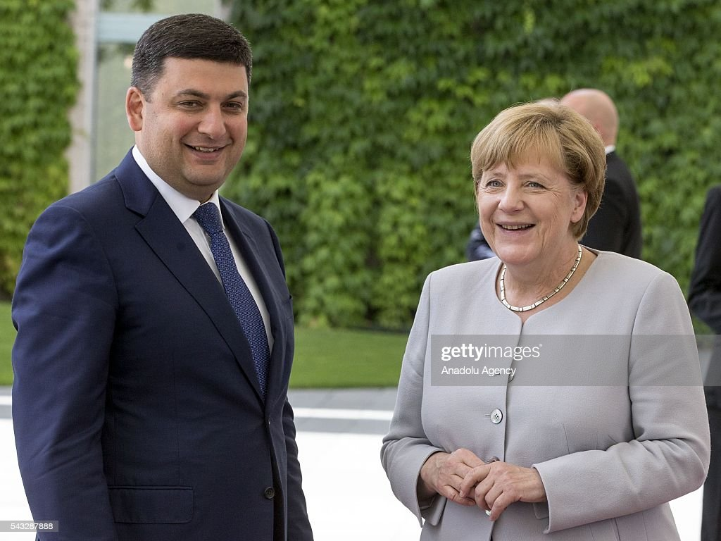 German Chancellor Angela Merkel (R) welcomes Prime Minister of Ukraine Volodymyr Groysman (L) during an official welcoming ceremony in Berlin, Germany on June 27, 2016.