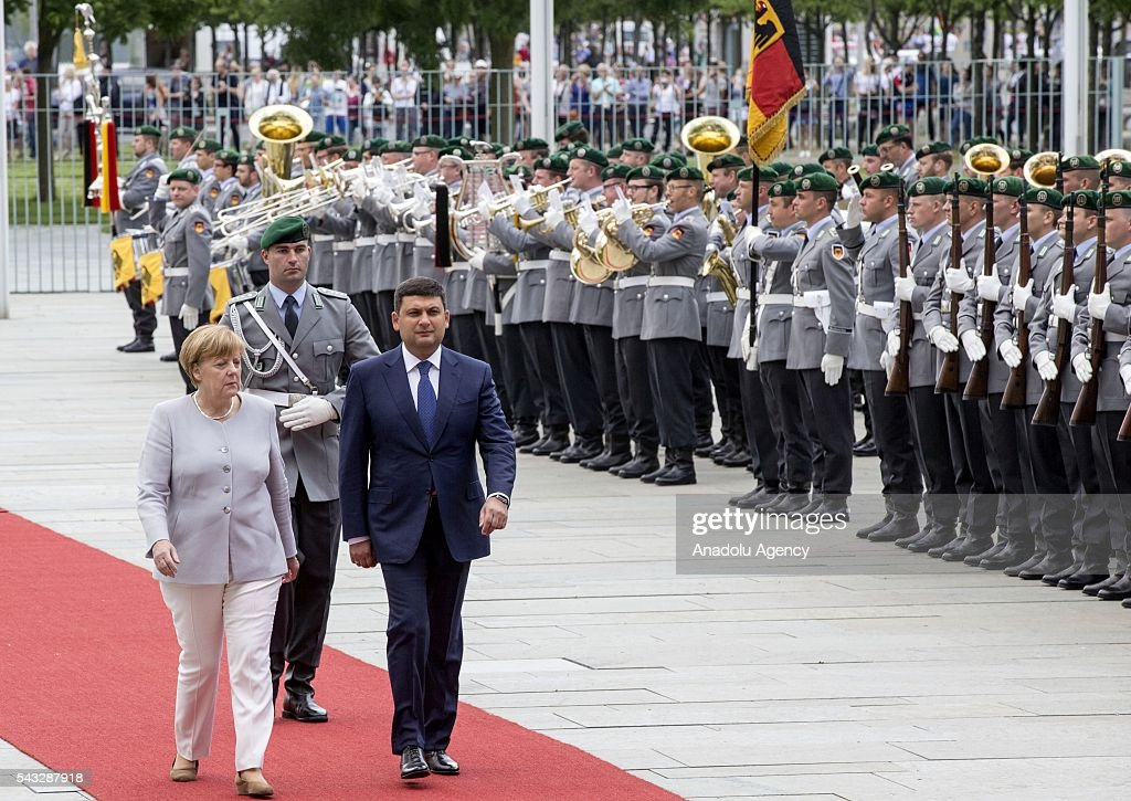 German Chancellor Angela Merkel (L) welcomes Prime Minister of Ukraine Volodymyr Groysman (R) during an official welcoming ceremony in Berlin, Germany on June 27, 2016.