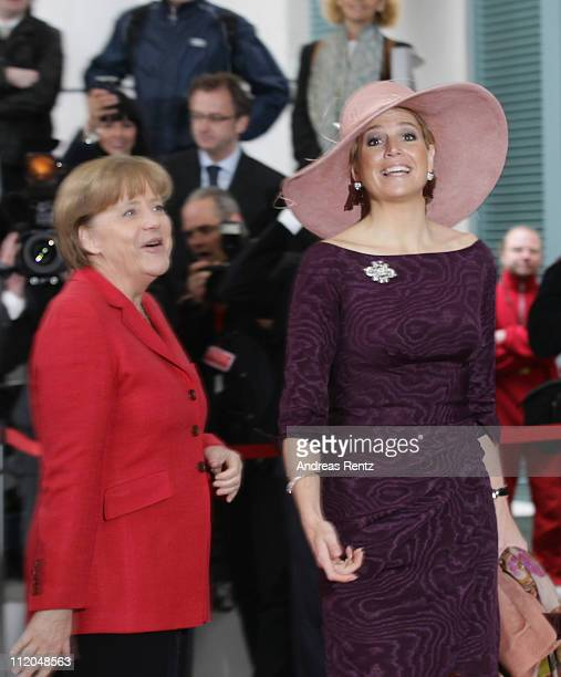 German Chancellor Angela Merkel welcomes Princess Maxima of the Netherlands upon her arrival at the Chancellery on April 12 2011 in Berlin Germany...