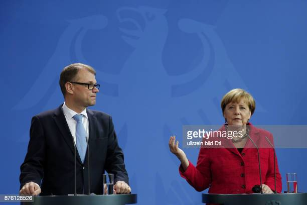 German Chancellor Angela Merkel welcomes the Finnish Prime Minister Juha Sipilas with military honors on September 22 2015 at the Federal Chancellery...
