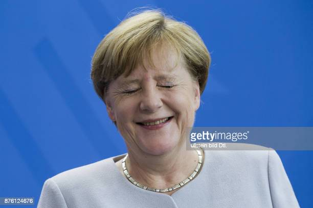 German Chancellor Angela Merkel welcomes the new Federal Chancellor of Austria Christian_Kern at 23 June 2016 with military honors at the Federal...