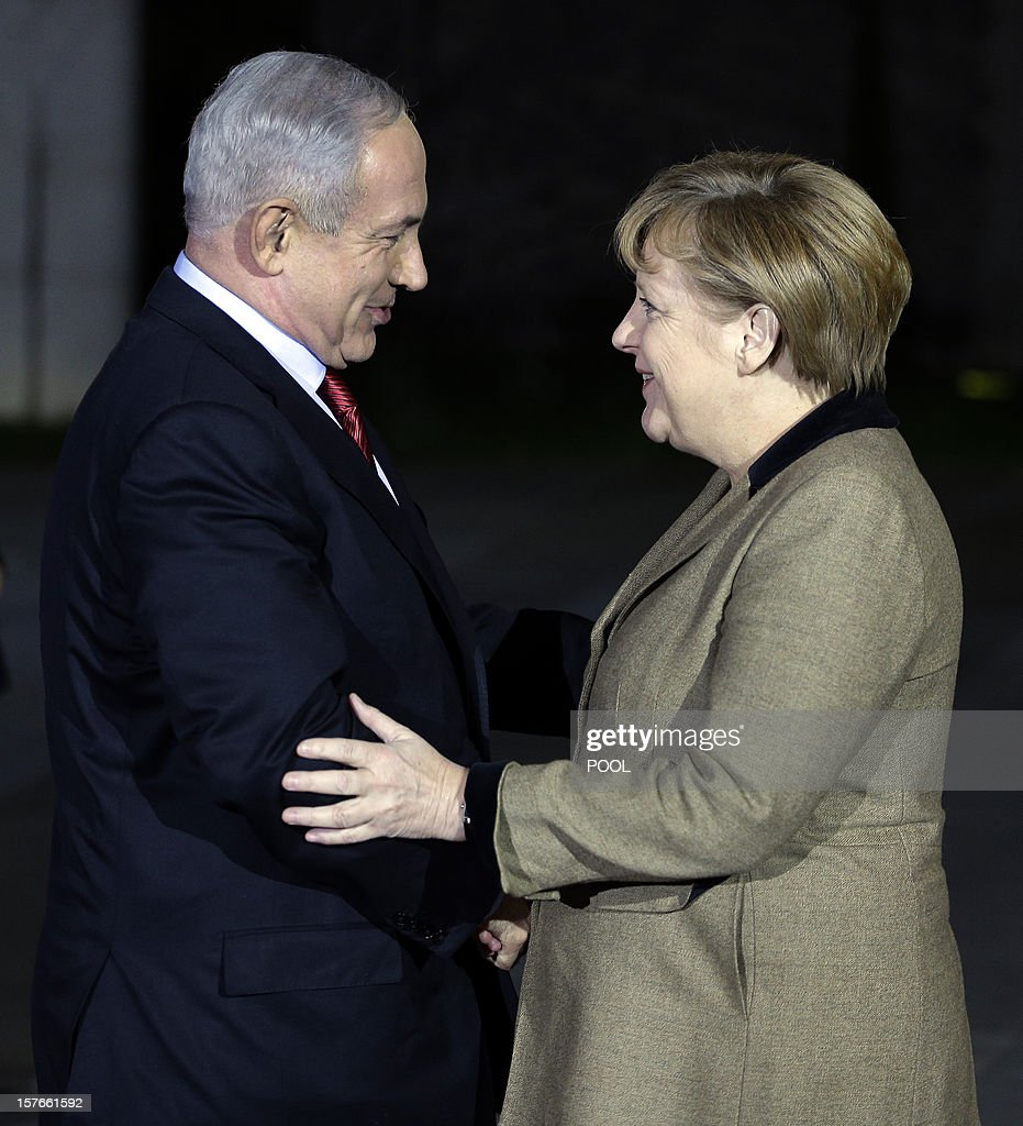 German Chancellor Angela Merkel (R) welcomes the Prime Minister of Israel, Benjamin Netanyahu , in front of the chancellery in Berlin on December 5, 2012 for a joint dinner prior to intergovernmental talks the following day.