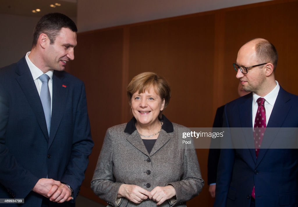 German Chancellor <a gi-track='captionPersonalityLinkClicked' href=/galleries/search?phrase=Angela+Merkel&family=editorial&specificpeople=202161 ng-click='$event.stopPropagation()'>Angela Merkel</a> (C) welcomes Ukraine opposition leaders <a gi-track='captionPersonalityLinkClicked' href=/galleries/search?phrase=Vitali+Klitschko&family=editorial&specificpeople=206402 ng-click='$event.stopPropagation()'>Vitali Klitschko</a> (L) and <a gi-track='captionPersonalityLinkClicked' href=/galleries/search?phrase=Arseniy+Yatsenyuk&family=editorial&specificpeople=4204919 ng-click='$event.stopPropagation()'>Arseniy Yatsenyuk</a> (R) at the Chancellery on February 17, 2014 in Berlin, Germany. Ukraine opposition leaders Klitschko and Yatsenyuk arein Berlin to discuss the country's crisis as the ex-Soviet nation has been in chaos since November when President Viktor Yanukovych ditched a planned EU trade and political pact in favour of closer ties with Moscow.