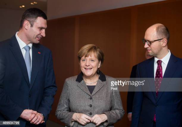 German Chancellor Angela Merkel welcomes Ukraine opposition leaders Vitali Klitschko and Arseniy Yatsenyuk at the Chancellery on February 17 2014 in...