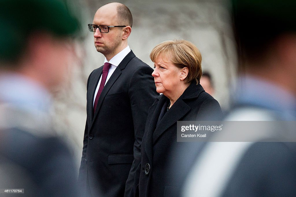 German Chancellor <a gi-track='captionPersonalityLinkClicked' href=/galleries/search?phrase=Angela+Merkel&family=editorial&specificpeople=202161 ng-click='$event.stopPropagation()'>Angela Merkel</a> (R) welcomes Ukrainian Prime Minister <a gi-track='captionPersonalityLinkClicked' href=/galleries/search?phrase=Arseniy+Yatsenyuk&family=editorial&specificpeople=4204919 ng-click='$event.stopPropagation()'>Arseniy Yatsenyuk</a> with the millitray honour ceremony upon Yatsenyuk's arrival for talks at the Chancellery on January 7, 2015 in Berlin, Germany. Merkel has been among the main western leaders seeking to mediate between Ukraine and Russia in an effort to bring an end to the armed conflict in eastern Ukraine.