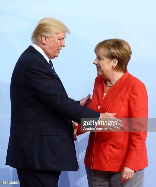 German Chancellor Angela Merkel welcomes US President Donald Trump during G20 Leaders' Summit in Hamburg Germany on July 07 2017 Germany is hosting...