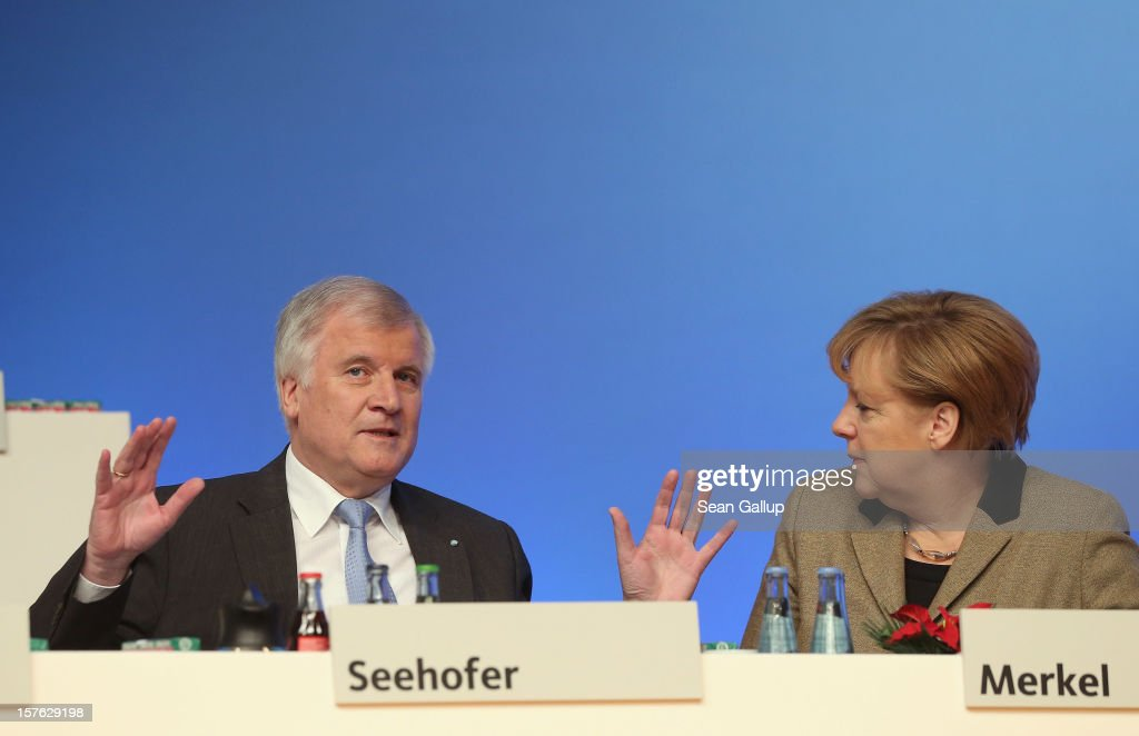 German Chancellor Angela Merkel, who is also chairwoman of the German Christian Democratic Union (CDU), chats with Horst Seehofer, Chairman of the Christian Social Union (CSU), the Bavarian sister party of the CDU, upon Seehofer's arrival at the CDU federal party convention on December 5, 2012 in Hanover, Germany. The CDU has a strong lead over its opponents though has recently lost the mayoral posts in several major German cities to opposition parties. Germany faces federal elections in 2013.