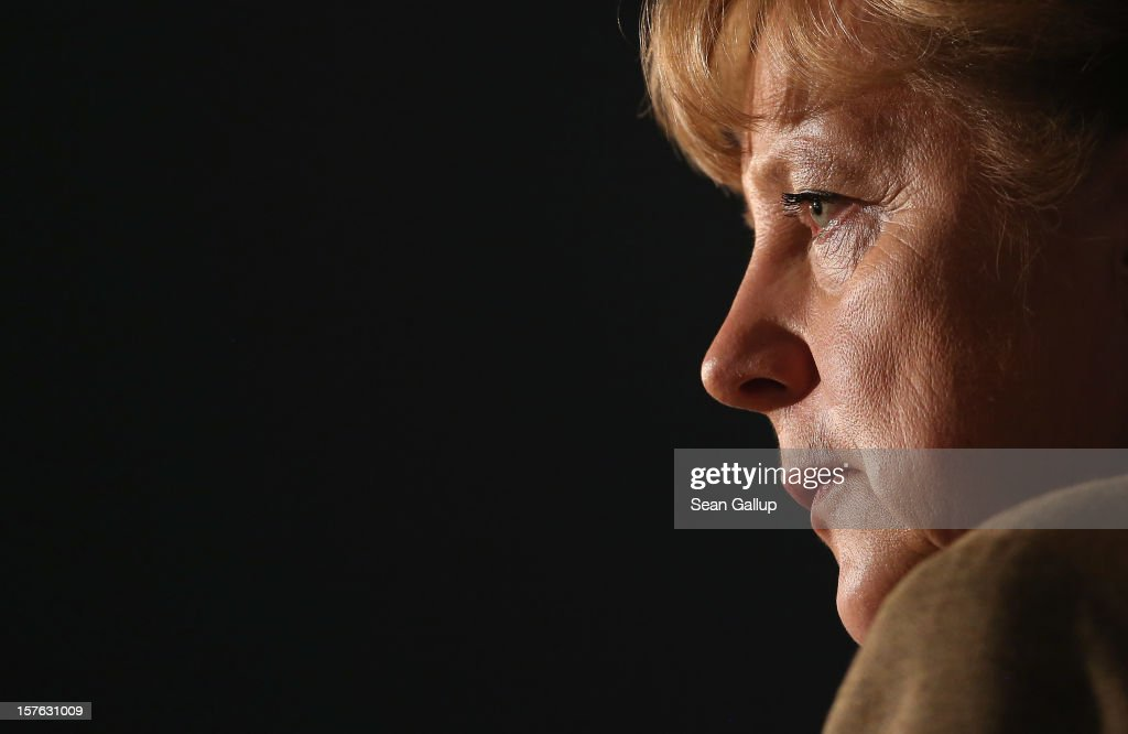 German Chancellor Angela Merkel, who is also chairwoman of the German Christian Democratic Union (CDU), gives a television interview at the conclusion of the CDU federal party convention on December 5, 2012 in Hanover, Germany. The CDU has a strong lead over its opponents though has recently lost the mayoral posts in several major German cities to opposition parties. Germany faces federal elections in 2013.