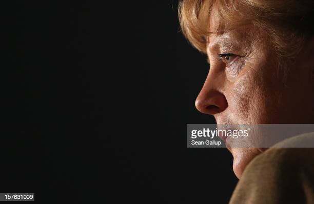German Chancellor Angela Merkel who is also chairwoman of the German Christian Democratic Union gives a television interview at the conclusion of the...