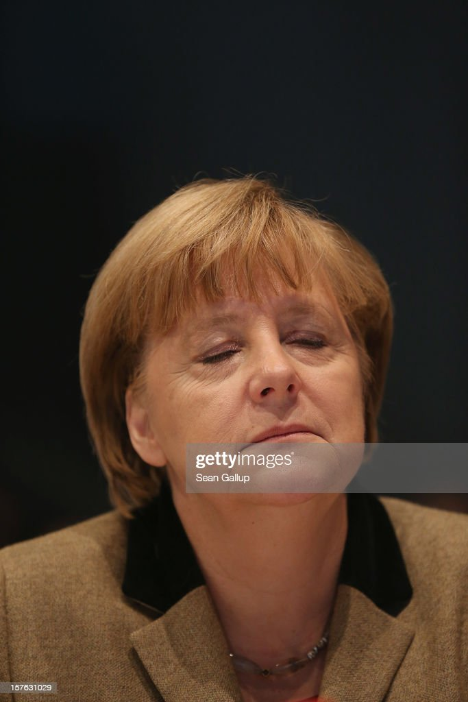 German Chancellor <a gi-track='captionPersonalityLinkClicked' href=/galleries/search?phrase=Angela+Merkel&family=editorial&specificpeople=202161 ng-click='$event.stopPropagation()'>Angela Merkel</a>, who is also chairwoman of the German Christian Democratic Union (CDU), attends the CDU federal party convention on December 5, 2012 in Hanover, Germany. The CDU has a strong lead over its opponents though has recently lost the mayoral posts in several major German cities to opposition parties. Germany faces federal elections in 2013.
