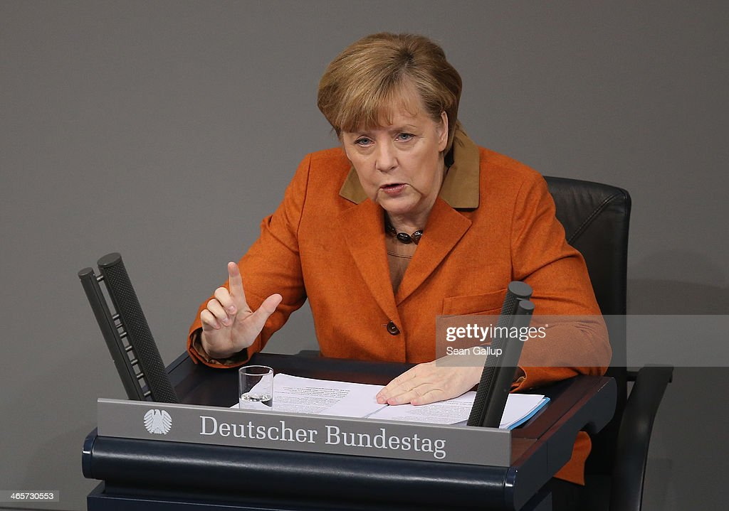 German Chancellor <a gi-track='captionPersonalityLinkClicked' href=/galleries/search?phrase=Angela+Merkel&family=editorial&specificpeople=202161 ng-click='$event.stopPropagation()'>Angela Merkel</a>, who is seated due to an injury, gives a government declaration to outline the policy priorities of the new German coalition government of Christian Democrats and Social Democrats on January 29, 2104 in Berlin, Germany. The new government was sworn in in December and has a strong majority in the Bundestag to push through legislation.