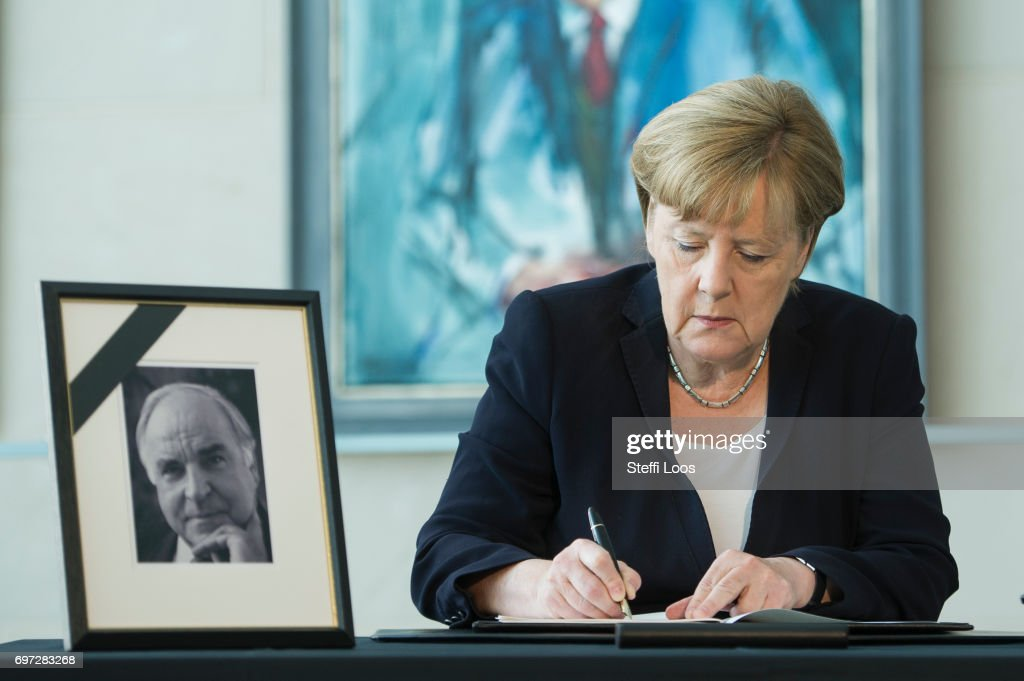 German Chancellor Angela Merkel writes in a condolences book for former chancellor Helmut Kohl in front of chancellor gallery at chancellery on June 18, 2017 in Berlin, Germany. Kohl, who was chancellor of Germany for 16 years and led the country from the Cold War through to reunification, died on June 16 at the age of 87.
