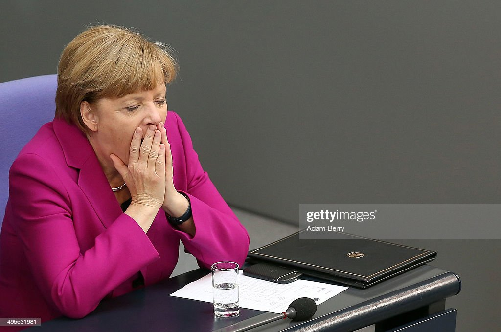 German Chancellor Angela Merkel yawns after giving a government declaration during a meeting of the Bundestag, the German federal parliament, on June 4, 2014 in Berlin, Germany. Merkel spoke in the Bundestag after attending a meeting in Brussels with the 28 European Union heads of state, where she continued to back Jean-Claude Juncker, leading candidate for the European People's Party (EPP) and former prime minister of Luxembourg, for the position of European Commission president.