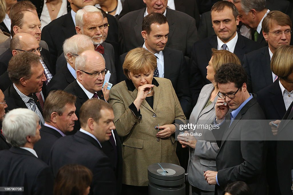 German Chancellor Angela Merkel yawns before casting her ballot on a measure at the Bundestag over the 2013 federal budget on November 21, 2012 in Berlin, Germany. Bundestag members are debating the budget over four days this week and will vote on the final budget on Friday.
