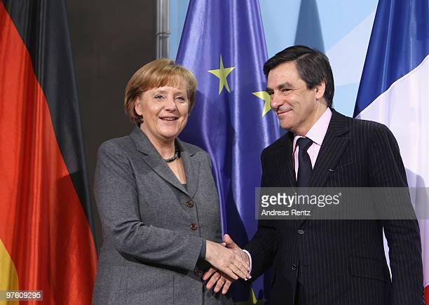 German Chancellor Anglea Merkel shakes hands with French Prime Minister Francois Fillon after a press conference at Chancellery on March 10 2010 in...