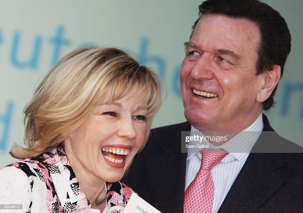 German Chancellor Gerhard Schroeder and his wife <a gi-track='captionPersonalityLinkClicked' href=/galleries/search?phrase=Doris+Schroeder-Koepf&family=editorial&specificpeople=224024 ng-click='$event.stopPropagation()'>Doris Schroeder-Koepf</a> share a laugh at the CeBIT technology trade fair March 10, 2005 in Hanover, Germany. CeBIT, the biggest technology trade fair in the world, runs from March 10-16.