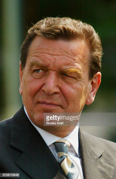 German Chancellor Gerhard Schroeder attends a joint news conference with US President George W Bush at the Bundeskanzleramt in Berlin