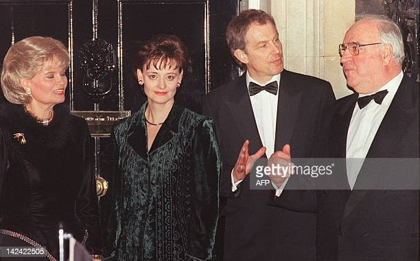 German Chancellor Helmut Kohl and his wife Hannelore pose 18 February with British Prime Minister Tony Blair and his wife Cherie as they arrive at No...