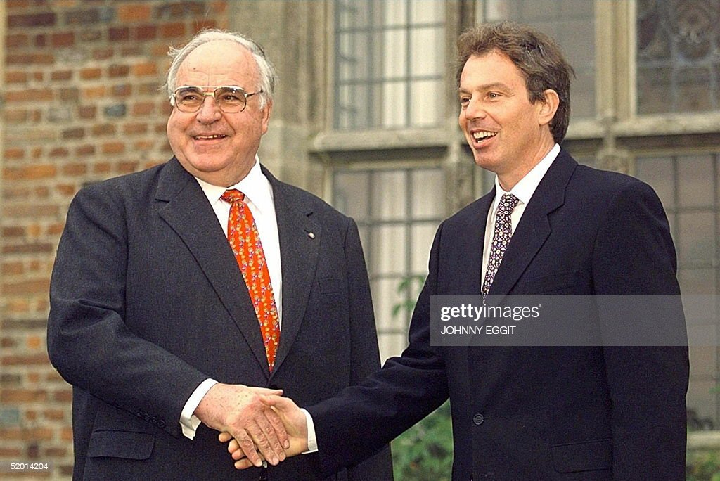 German Chancellor, Helmut Kohl (L) is greeted by British Prime Minister Tony Blair (R) as he arrives 20 October at the Prime Minister's official country residence, Chequers. The single european was expected to dominate their informal talks.