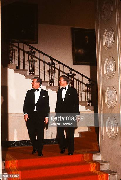 German Chancellor Helmut Schmidt left walks alongside American President Jimmy Carter at a White House reception Washington DC March 1980