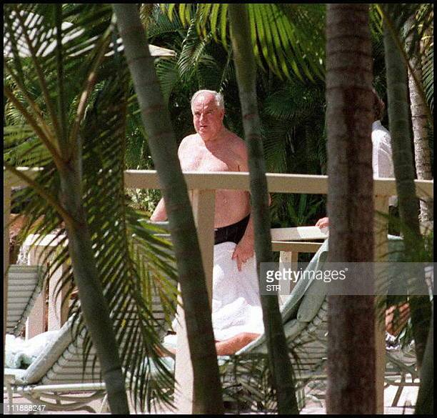 German Chancellor Hulmut Kohl relaxes in a pair of bathers at a holiday resort at Port Douglas nears Cairns yesterday 04 May Kohl is on a five day...
