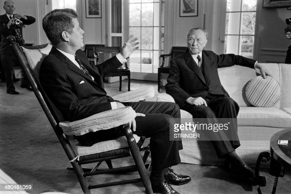 German Chancellor Konrad Adenauer listens to US President John F Kennedy during his visit to the White House in Washington on November 16 1962 AFP...
