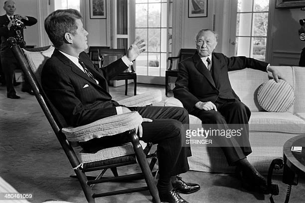 German Chancellor Konrad Adenauer listens to US President John F Kennedy during his visit to the White House in Washington on November 16 1962 AFP...