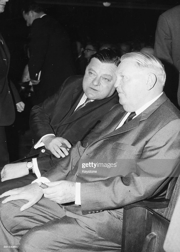 German Chancellor Ludwig Erhard talking to Franz Josef Strauss Leader of the CSU Party at a party meeting in Munich July 12th 1964