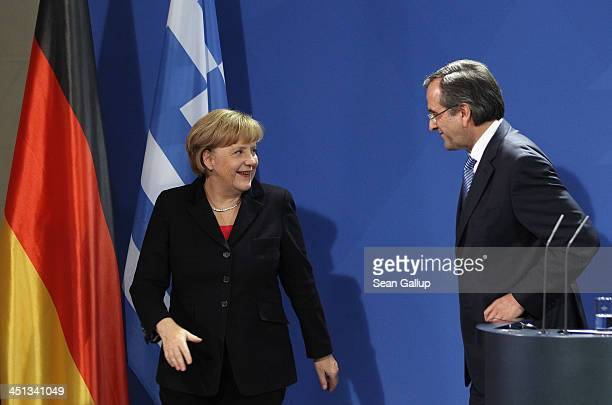 German Chanellor Angela Merkel and Greek Prime Minister Antonis Samaras depart afther they spoke to the media following talks at Chancellery on...