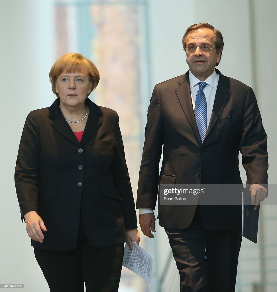 German Chanellor <a gi-track='captionPersonalityLinkClicked' href=/galleries/search?phrase=Angela+Merkel&family=editorial&specificpeople=202161 ng-click='$event.stopPropagation()'>Angela Merkel</a> and Greek Prime Minister <a gi-track='captionPersonalityLinkClicked' href=/galleries/search?phrase=Antonis+Samaras&family=editorial&specificpeople=970799 ng-click='$event.stopPropagation()'>Antonis Samaras</a> arrive to speak to the media following talks at Chancellery (Bundeskanzleramt) on November 22, 2013 in Berlin, Germany. Recent figures suggest the Greek economy is reaching the end of it recession.