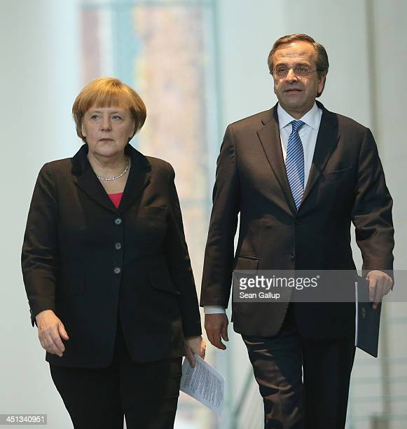 German Chanellor Angela Merkel and Greek Prime Minister Antonis Samaras arrive to speak to the media following talks at Chancellery on November 22...