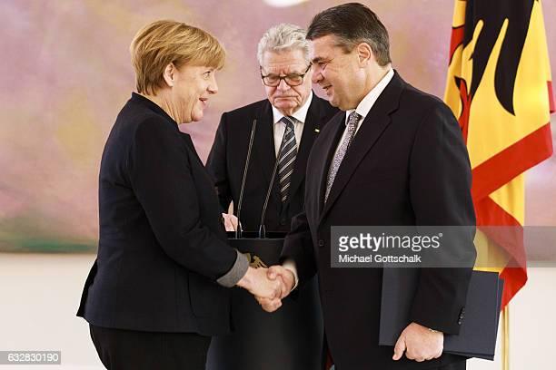 German Chanellor Angela Merkel German President Joachim Gauck German Minister for Economics Sigmar Gabriel attend a ceremony at Bellevue Palace on...