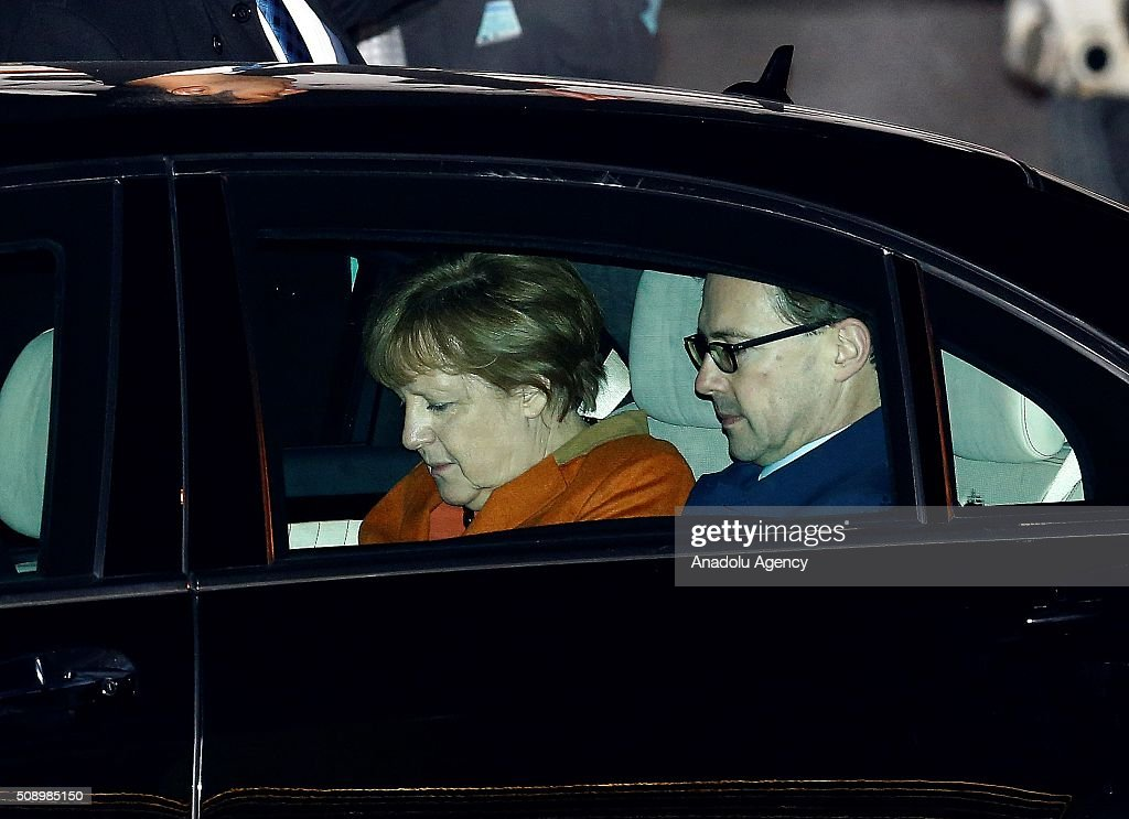 German Changellor Angela Merkel is seen in a car after arriving at Esenboga International Airport early Monday on February 8, 2016 in Ankara, Turkey.
